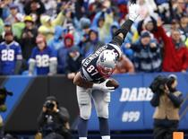 Oct 30, 2016; Orchard Park, NY, USA; New England Patriots tight end Rob Gronkowski (87) takes a bow after scoring a touchdown during the first half against the Buffalo Bills at New Era Field. Mandatory Credit: Kevin Hoffman-USA TODAY Sports