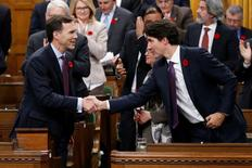 Canada's Prime Minister Justin Trudeau (R) shakes hands with Finance Minister Bill Morneau after Morneau delivered the Fall Economic Statement in the House of Commons on Parliament Hill in Ottawa, Ontario, Canada, November 1, 2016. REUTERS/Chris Wattie