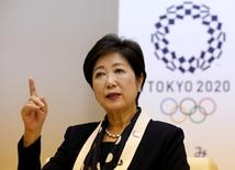 Tokyo Governor Yuriko Koike speaks in front of Tokyo 2020 Olympics emblem during an interview with Reuters at Tokyo Metropolitan Government Building in Tokyo, Japan, October 12, 2016.    REUTERS/Toru Hanai