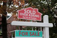 """A """"Sold over asking"""" sign is on display on a house for sale in Toronto's housing market in Toronto, Ontario, Canada, October 21, 2016. REUTERS/Hyungwon Kang"""