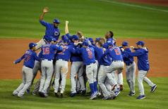 Chicago Cubs players celebrate after defeating the Cleveland Indians. Charles LeClaire-USA TODAY Sports