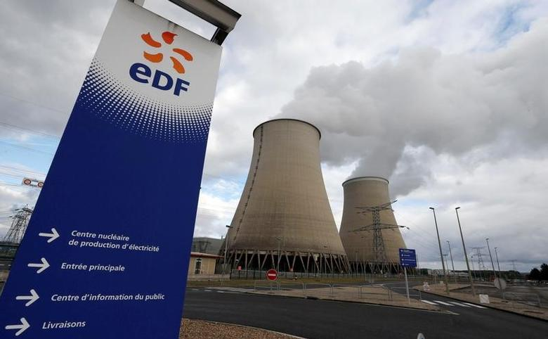 The logo of Electricite de France (EDF) is seen at the entrance of the nuclear power plant as steam rises from the cooling towers in Nogent-sur-Seine, France, October 20, 2016.   REUTERS/Regis Duvignau/File Photo