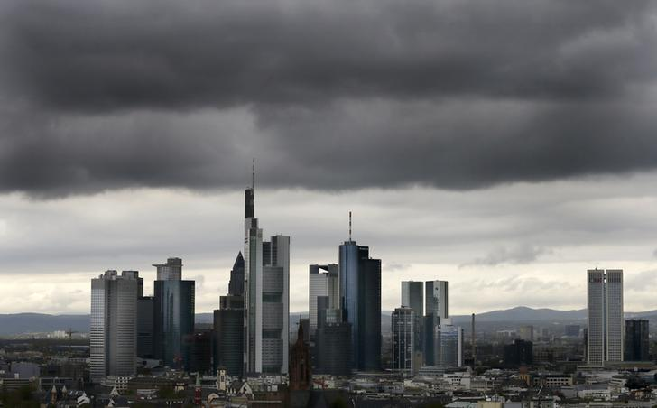 The skyline of Frankfurt with its bank towers under dark clouds is seen from the construction site of the new headquarters of the European Central Bank (ECB) during a guided tour in Frankfurt, April 26, 2012. The European Central Bank plans to move its headquarters in early 2014.  REUTERS/Kai Pfaffenbach (GERMANY - Tags: BUSINESS POLITICS)
