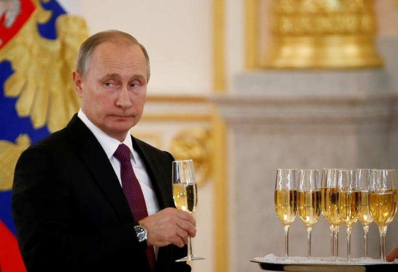 Russia's President Vladimir Putin holds a glass during a ceremony of receiving diplomatic credentials from foreign ambassadors at the Kremlin in Moscow, Russia, November 9, 2016. REUTERS/Sergei Karpukhin