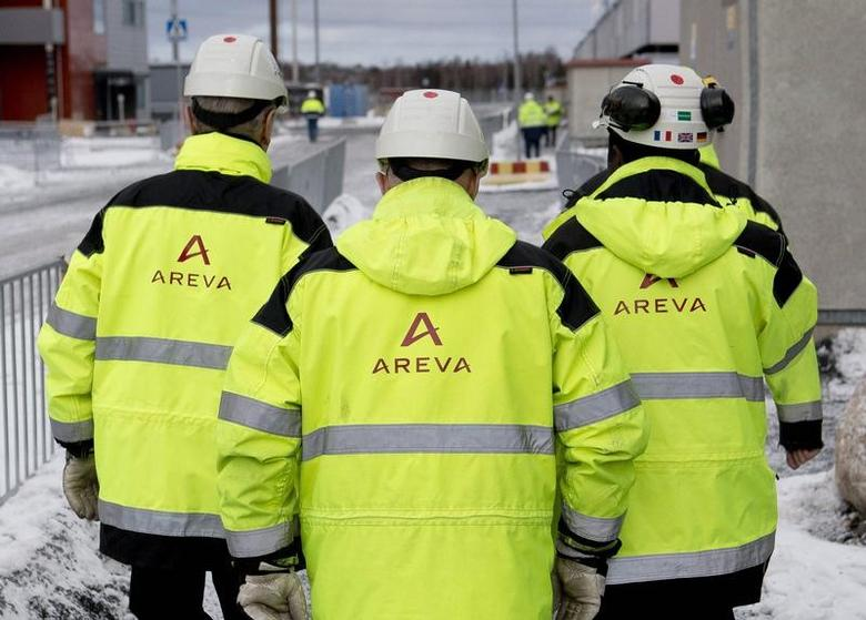 Workers wearing vests with the logo of French nuclear company Areva walk at the Olkiluoto 3 (OL3) nuclear power plant in Eurajoki March 8, 2013.  REUTERS/Roni Lehti/Lehtikuva