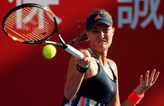 Tennis - Hong Kong Open semi-finals - Daria Gavrilova of Australia v Kristina Mladenovic of France - Hong Kong, China - 15/10/16. Mladenovic returns a shot. REUTERS/Bobby Yip