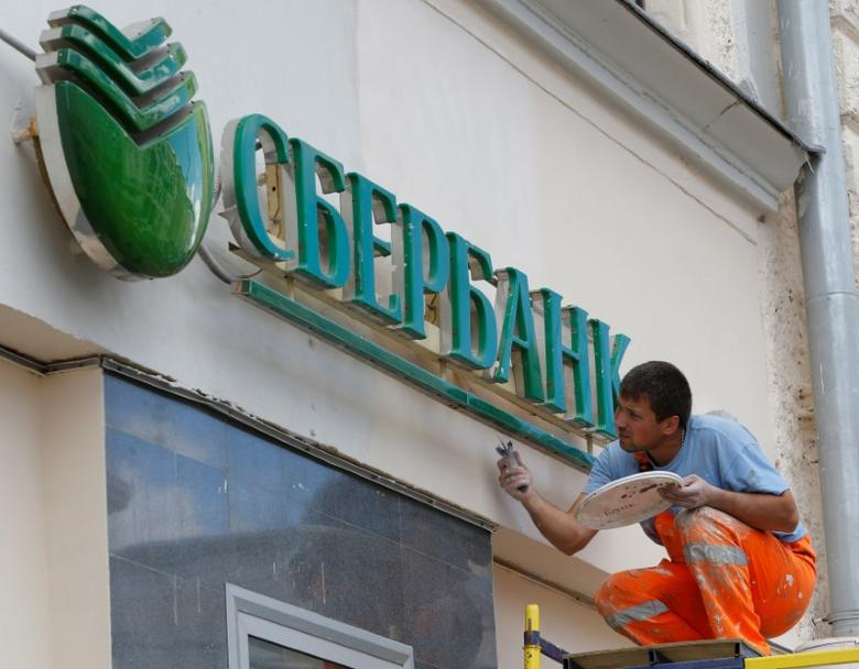 A worker paints the facade of a branch of Sberbank in central Moscow, Russia, August 17, 2016. REUTERS/Sergei Karpukhin