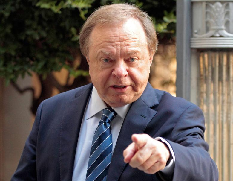 Harold Hamm, founder and CEO of Continental Resources, enters the courthouse for divorce proceedings with wife Sue Ann Hamm in Oklahoma City, Oklahoma, U.S. on September 22, 2014.  REUTERS/Steve Sisney/File Photo