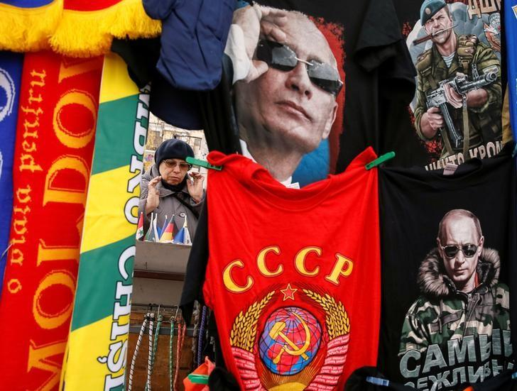 Mythologizing Putin: T-shirts depicting images of Russia's President Vladimir Putin and the former Soviet Union emblem for sale in central Chisinau, Moldova, November 12, 2016. REUTERS/Gleb Garanich