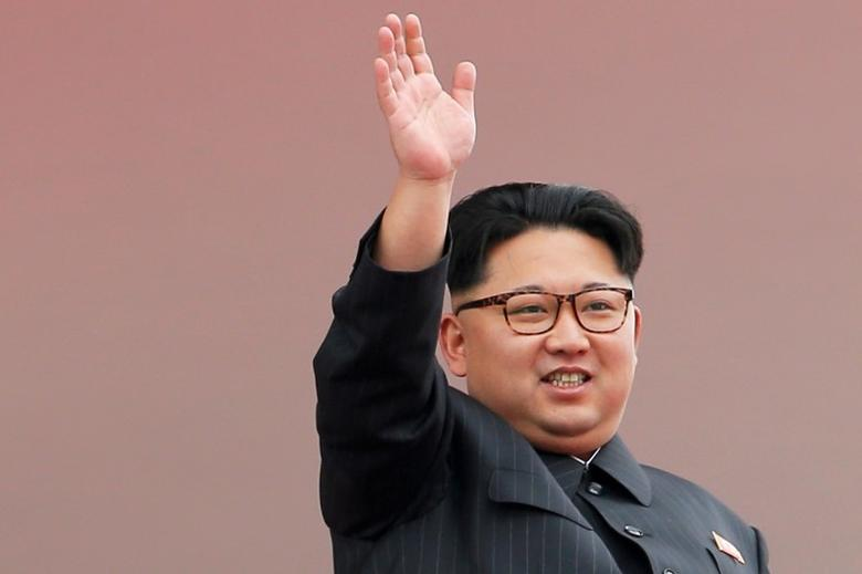 North Korean leader Kim Jong Un waves to the crowd as he presides over a mass rally and parade in the capital's main ceremonial square, in Pyongyang, North Korea, May 10, 2016. REUTERS/Damir Sagolj/File Photo