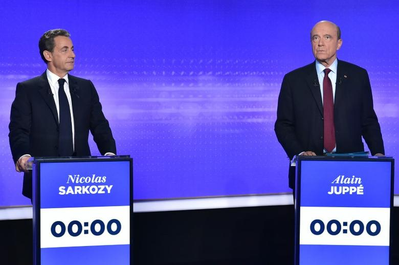 French politicians Nicolas Sarkozy (L) and Alain Juppe attend the final prime-time televised debate for the French center-right presidential primary in Paris, France, November 17, 2016.   REUTERS/Christphe Archambault/Pool