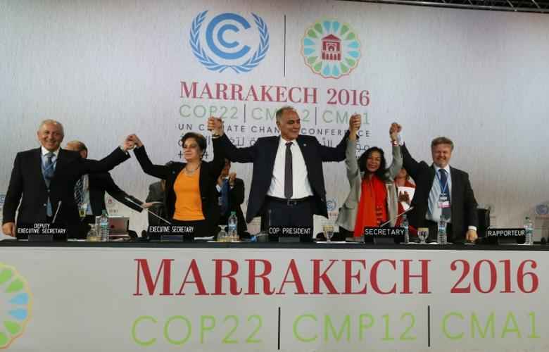 U.N. climate chief Patricia Espinosa (2nd L), Morocco's Foreign Minister Salaheddine Mezouar (C), and Council of Europe Goodwill Ambassador Bianca Jagger (2nd R) celebrate after the proclamation of Marrakech, at the UN World Climate Change Conference 2016 (COP22) in Marrakech, Morocco, November 17, 2016. REUTERS/Stringer