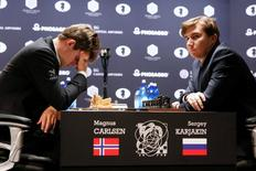 Magnus Carlsen, of Norway, reacts at his match with Sergey Karjakin, of Russia, during their round 5 of the 2016 World Chess Championship in New York U.S., November 17, 2016. REUTERS/Shannon Stapleton