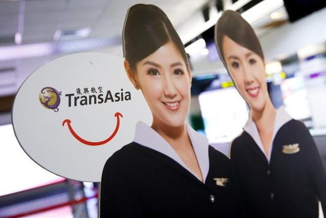 A paper cutout depicting flight attendants of Taiwan's third-largest airline, TransAsia Airways Corp. is seen in front of its counter after the company applied to suspend its flights without giving any earlier warning at Songshan Airport in Taipei, Taiwan November 21, 2016. REUTERS/Tyrone Siu - RTSSNWB