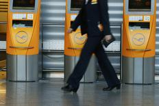 A worker walks past a closed check-in area during a pilots strike of German airline Lufthansa at Frankfurt airport, Germany, November 23, 2016. REUTERS/Ralph Orlowski