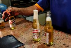 Bottles of Regional beer are seen at a bar in Caracas, Venezuela November 15, 2016. Picture taken November 15, 2016. REUTERS/Marco Bello
