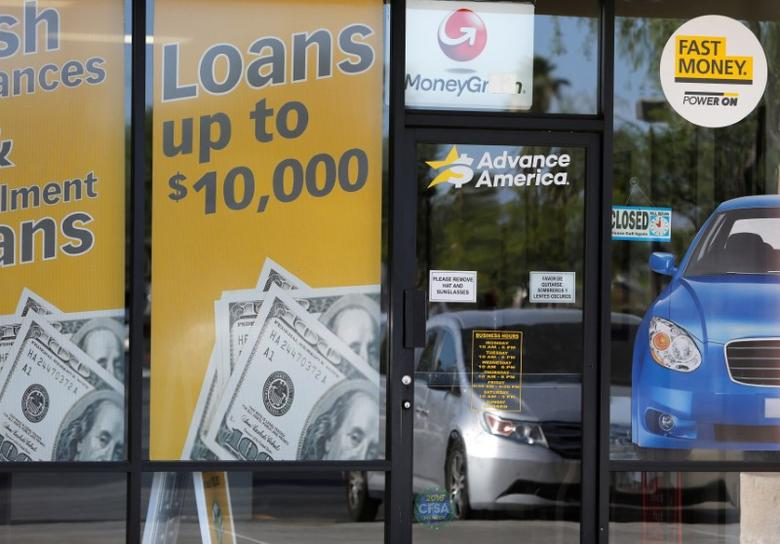 The storefront of an Advance America loan store is shown in Palm Springs, California, U.S. June 2, 2016.  REUTERS/Sam Mircovich