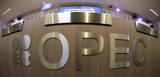 A table with OPEC logo is seen during the presentation of OPEC's 2013 World Oil Outlook in Vienna , in this November 7, 2013 file photo. REUTERS/Leonhard Foeger