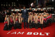 "Athlete Usain Bolt (C) poses for photographers with dancers at the world premiere of the film ""I am Bolt"" in London, Britain November 28, 2016. REUTERS/Neil Hall"