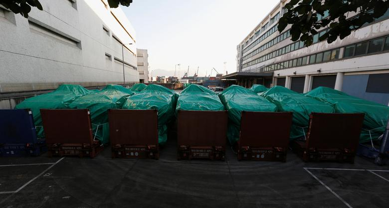Armored troop carriers, belonging to Singapore, are detained at a cargo terminal in Hong Kong, China November 28, 2016. REUTERS/Bobby Yip
