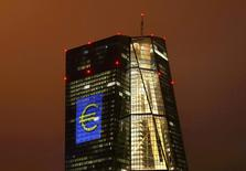 "The headquarters of the European Central Bank (ECB) are illuminated with a giant euro sign at the start of the ""Luminale, light and building"" event in Frankfurt, Germany, March 12, 2016.   EUTERS/Kai Pfaffenbach/File Photo"