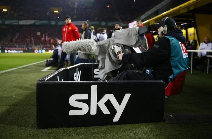 A camera operator of TV media service provider Sportcast  is pictured during the broadcast of German Bundesliga first division soccer match between Borussia Dortmund and Bayern Munich of pay-TV SKY at the Signal Iduna Park in Dortmund, Germany, March 5, 2016.    REUTERS/Wolfgang Rattay - RTS9SNU