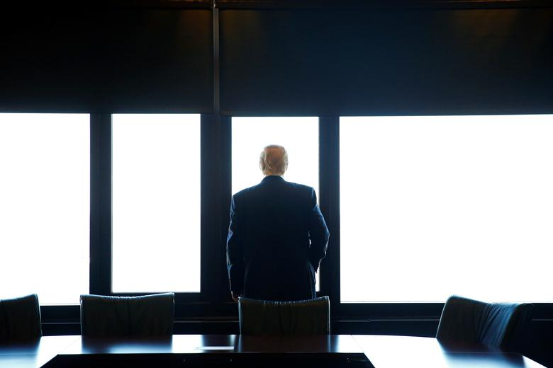 Donald Trump looks out at Lake Michigan during a visit to the Milwaukee County War Memorial Center in Milwaukee, Wisconsin August 16, 2016. REUTERS/Eric Thayer
