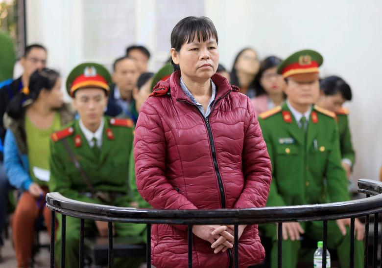 Can Thi Theu, a farmer and land protection activist, stands in the dock during her appeal trial at a court in Hanoi, Vietnam November 30, 2016. Mandatory credit VNA/Doan Tan/via REUTERS