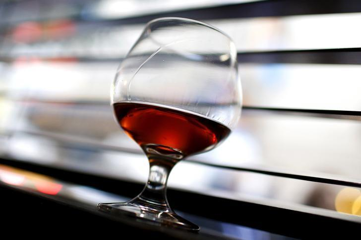 A glass of cognac is pictured on a bar in the Manhattan borough of New York City, November 13, 2015. REUTERS/Mike Segar