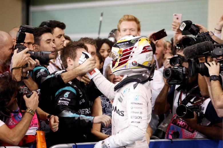 Formula One - F1 - Abu Dhabi Grand Prix - Yas Marina Circuit, Abu Dhabi, United Arab Emirates - 27/11/2016 - Mercedes' Formula One driver Lewis Hamilton of Britain celebrates after winning the race. REUTERS/Hamad I Mohammed - RTSTJGT