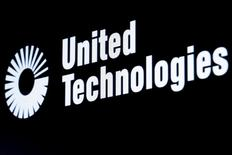 The ticker symbol for United Technologies is displayed at the post where it is traded on the floor of the New York Stock Exchange (NYSE) February 23, 2016. REUTERS/Brendan McDermid/File Photo