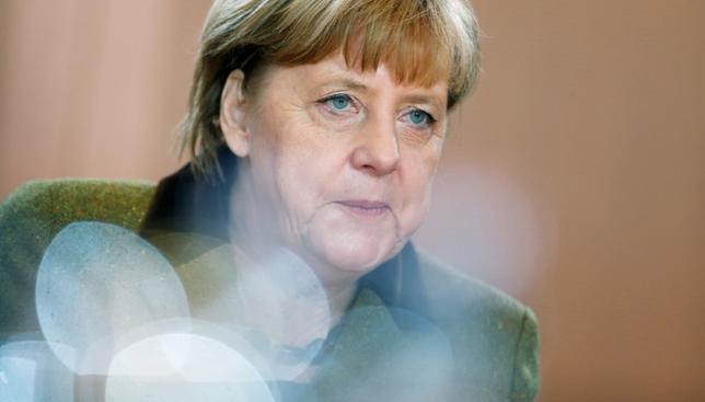 German Chancellor Angela Merkel attends the weekly cabinet meeting at the chancellery in Berlin, Germany, November 30, 2016. REUTERS/Hannibal Hanschke