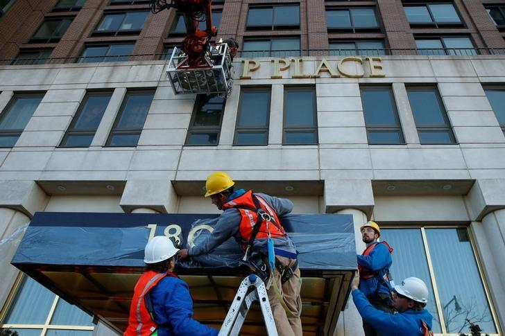Workers remove signage on the Trump Place apartment buildings on Manhattan's Upper West Side in New York City, U.S., November 16, 2016.  REUTERS/Brendan McDermid