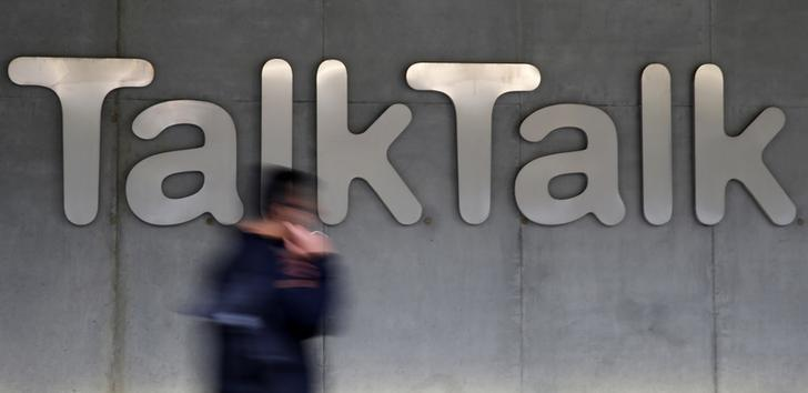 A man walks past a company logo outside a TalkTalk building in London, in this file photograph dated October 23, 2015.   REUTERS/Stefan Wermuth/files