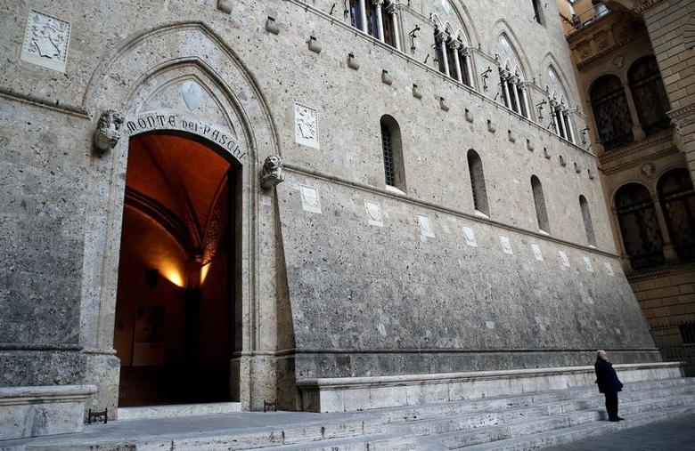 A man makes a phone call near the entrance of the Monte dei Paschi bank headquarters in Siena, Italy, November 4, 2014.     REUTERS/Giampiero Sposito/File Photo