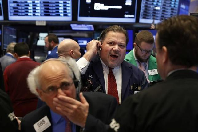Traders work on the floor of the New York Stock Exchange (NYSE) shortly after the opening bell in New York City, NY, U.S. November 15, 2016. REUTERS/Lucas Jackson/Files