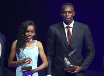 Usain Bolt of Jamaica (R) and Almaz Ayana of Ethiopia pose with their awards after being elected male and female World Athlete of the Year 2016 in Monaco, December 2, 2016.  REUTERS/Eric Gaillard