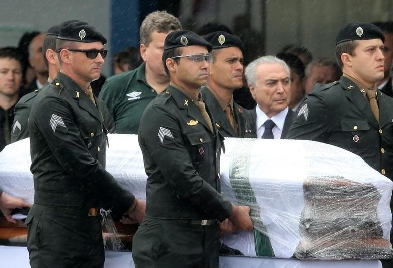 Brazilian President Michel Temer receives the coffin of Chapecoense player Thiaguinho who died on the plane crash in Colombia, in Chapeco, Brazil December 3, 2016. REUTERS/Paulo Whitaker