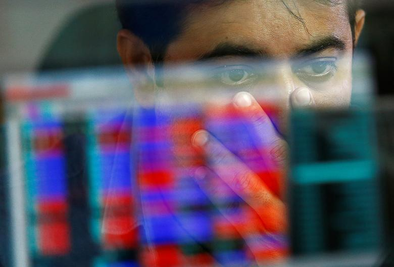 A broker reacts while trading at his computer terminal at a stock brokerage firm in Mumbai, India, November 9, 2016. REUTERS/Danish Siddiqui