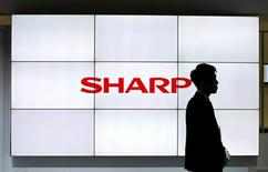A logo of Sharp Corp is pictured at CEATEC (Combined Exhibition of Advanced Technologies) JAPAN 2016 at the Makuhari Messe in Chiba, Japan, October 3, 2016.   REUTERS/Toru Hanai/File Photo