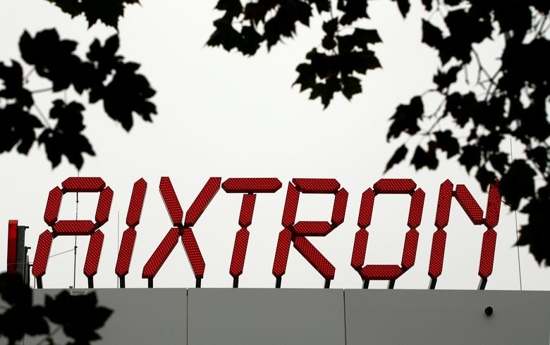 The logo of Aixtron SE is pictured on the roof of the German chip equipment maker's headquarters in Herzogenrath near the western German city of Aachen, October 25, 2016. REUTERS/Wolfgang Rattay/File Photo