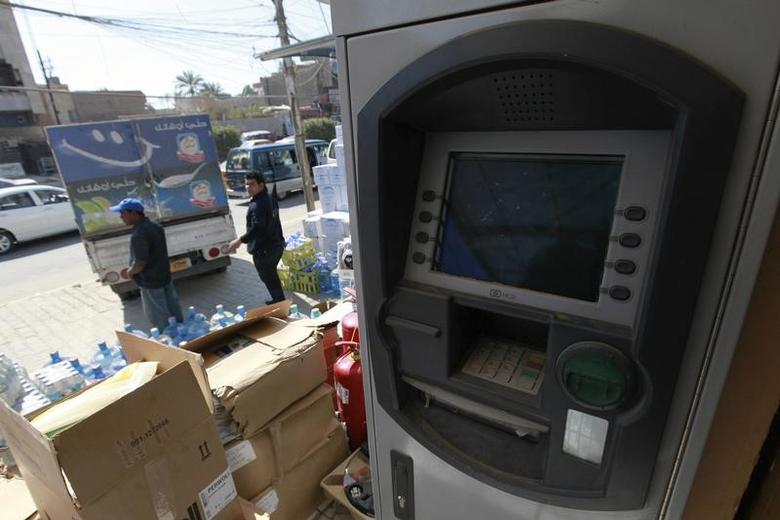 An abandoned ATM machine is seen outside a market in Baghdad March 4, 2012.   REUTERS/Mohammed Ameen