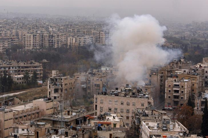 Smoke rises near Bustan al-Qasr crossing point in a government controlled area, during clashes with rebels in Aleppo, Syria December 5, 2016. REUTERS/Omar Sanadiki