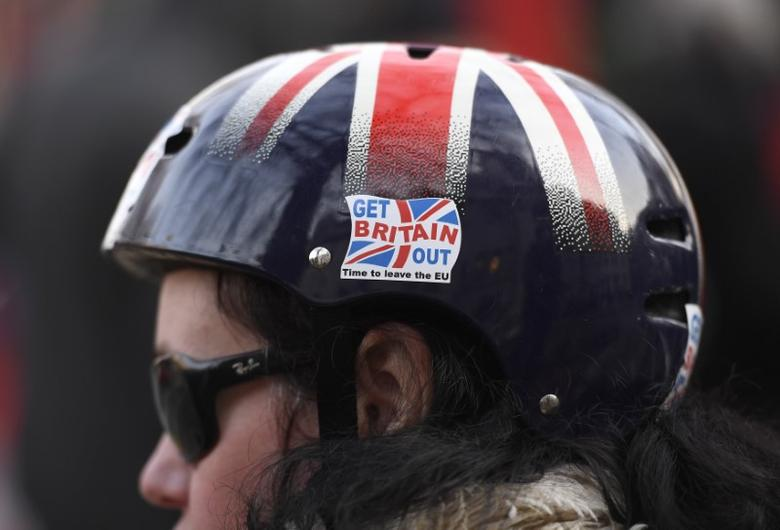 A cyclist wears a pro-Brexit badge on her Union flag themed helmet outside the Supreme Court on the first day of the challenge against a court ruling that Theresa May's government requires parliamentary approval to start the process of leaving the European Union, in Parliament Square, central London, Britain December 5, 2016. REUTERS/Toby Melville  - RTSUQYZ