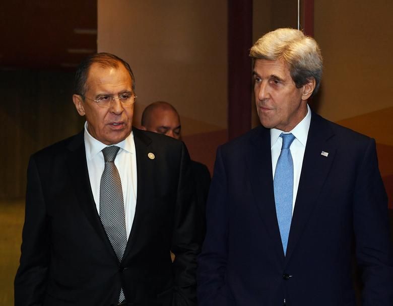 Russian Foreign Minister Sergey Lavrov (L) and U.S. Secretary of State John Kerry leave after their bilateral meeting at the APEC Ministers Summit in Lima, Peru November 17, 2016.   REUTERS/Mark Ralston/Pool