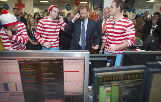 Britain's Prince Harry takes part in a charity trading day at ICAP on the Aus/Nz forwards Desk with Jack O'Brien and Phil McMahon in support of his charity Sentebale, in London, December 7, 2016. REUTERS/Geoff Pugh/Pool