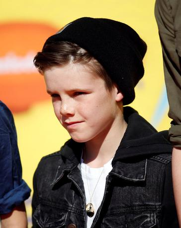 Cruz Beckham, son of David and Victoria Beckham, arrives at the 2015 Kids' Choice Awards in Los Angeles, California March 28, 2015. REUTERS/Danny Moloshok/File Photo