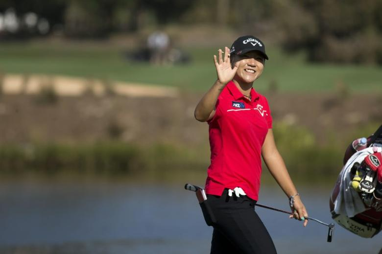 Nov 18, 2016; Naples, FL, USA; Lydia Ko of New Zealand waves to the crowd as she walks towards the eighteenth green during the CME Group Tour Championship at Tiburon Golf Club. Mandatory credit: Luke Franke/Naples Daily News via USA TODAY NETWORK