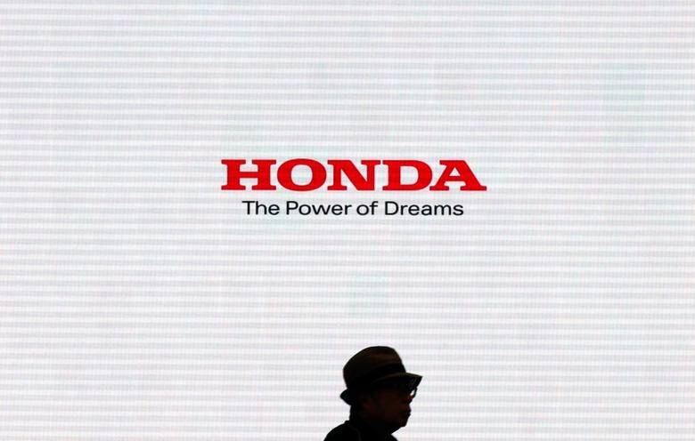 A man is silhouetted against a logo of Honda Motor at the company's showroom in Tokyo, Japan, May 13, 2016.   REUTERS/Toru Hanai