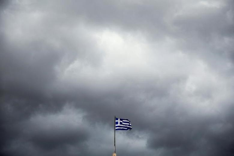 A Greek national flag flutters atop the Athens' University, Greece, May 5, 2016. REUTERS/Alkis Konstantinidis